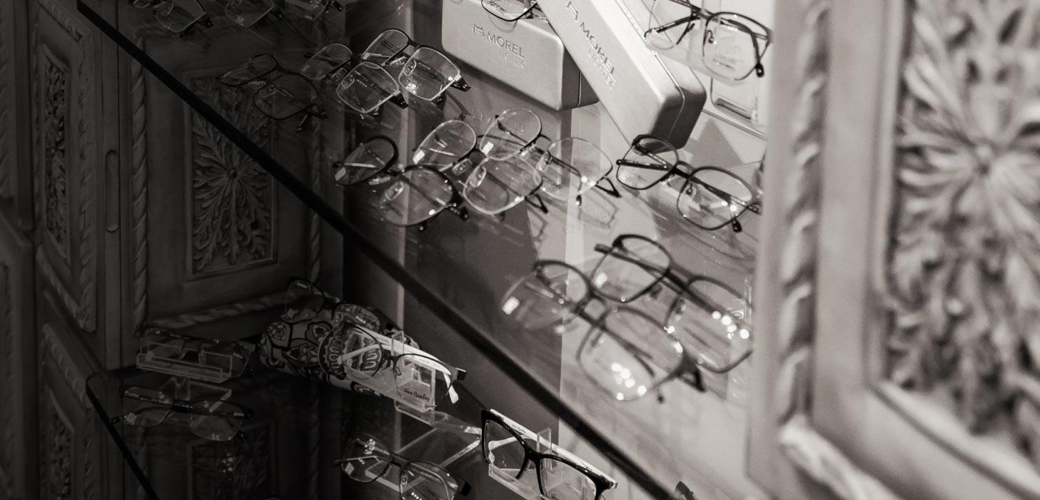 Glasses on a display shelf.